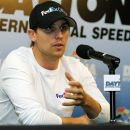 Denny Hamlin answers questions during a news conference after a practice session for the NASCAR Sprint Cup Series Coke Zero 400 auto race at Daytona International Speedway, Thursday, July 5, 2012, in Daytona Beach, Fla. Hamlin was unable to practice because of an injury. (AP Photo/Terry Renna)