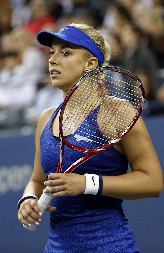 Sabine Lisicki, of Germany, reacts after losing a point to Maria Sharapova, of Russia, during the third round of the U.S. Open tennis tournament Friday, Aug. 29, 2014, in New York