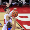 Wisconsin's Frank Kaminsky, behind, blocks a shot by Boise State's Anthony Drmic during the first half of an NCAA college basketball game Saturday, Nov. 22, 2014, in Madison, Wis. (AP Photo/Andy Manis)