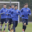 Arsenal's Olivier Giroud, right, Mikel Arteta, centre, and Laurent Koscielny, left, jog during a training session at their London Colney training ground, Monday, March 10, 2014. Arsenal will play in a Champions League last sixteen second leg soccer match