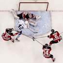 Toronto Maple Leafs center Tyler Bozak (42) gets his shot blocked by New Jersey Devils goalie Cory Schneider (35) as Adam Larsson (5), of Sweden, Adam Henrique (14) and Andy Greene (6) help defend during the first period of an NHL hockey game, Wednesday,