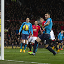 Manchester United's Marcos Rojo, centre right in red, watches as the ball heads goalwards as teammate Juan Mata, out of frame, scores from a free kick during the English Premier League soccer match between Manchester United and Stoke City at Old Trafford