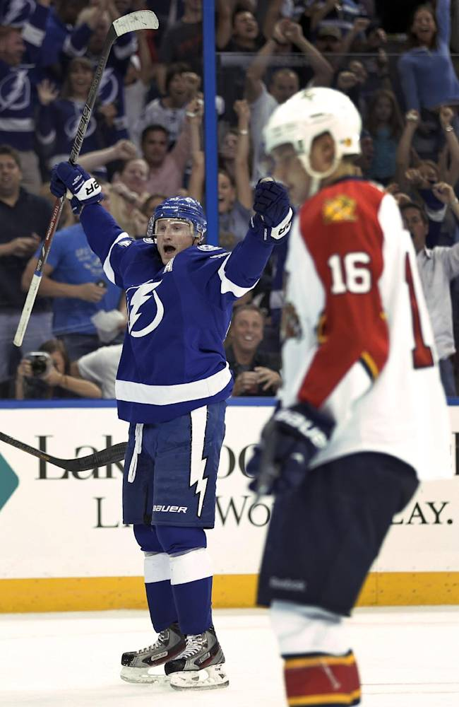 Tampa Bay Lightning center Steven Stamkos (91) celebrates in front of Florida Panthers center Aleksander Barkov (16), of Finland, after scoring during the second period of an NHL hockey game Thursday, Oct. 10, 2013, in Tampa, Fla