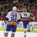 Nelson, Boychuk help Islanders top Canes 5-3 The Associated Press