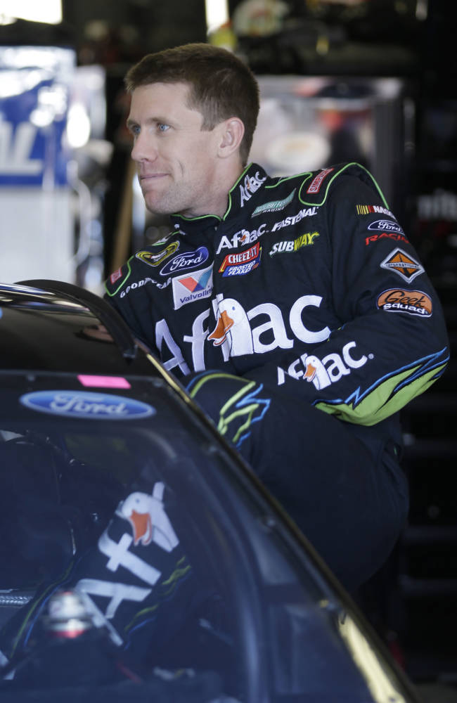 Driver Carl Edwards climbs into his car for the final practice session for Sunday's NASCAR Sprint Cup series auto race at Texas Motor Speedway in Fort Worth, Texas,  Saturday, Nov. 2, 2013.  Edwards is starting from the pole position