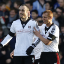 Fulham's Dimitar Berbatov, left, celebrates his penalty goal against Aston Villa with teammate Steve Sidwell during their English Premier League soccer match at Craven Cottage, London, Sunday, Dec. 8, 2013