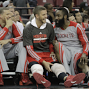 Houston Rockets' Francisco Garcia, left, Chandler Parsons, center and James Harden enjoy the closing moments of the Rockets 129-103 win over the Sacramento Kings in a NBA basketball game in Sacramento, Calif., Tuesday Feb. 25, 2014 The Associated Press