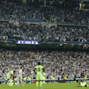 Manchester City players react after losing the Champions League semifinal second leg soccer match between Real Madrid and Manchester City at the Santiago Bernabeu stadium in Madrid, Wednesday May 4, 2016. (AP Photo/Paul White)