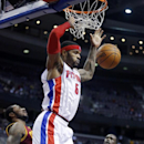 Detroit Pistons forward Josh Smith (6) dunks the ball in front of Cleveland Cavaliers forwards Earl Clark and Luol Deng (9) during the second half of an NBA basketball game Wednesday, Feb. 12, 2014, in Auburn Hills, Mich The Associated Press