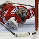 In this Nov. 12, 2013 file photo, Carolina Hurricanes goalie Justin Peters (35) eyes the puck as a teammate clears during the first period of an NHL hockey game against the Colorado Avalanche in Raleigh, N.C. The Washington Capitals opened free agency Tue