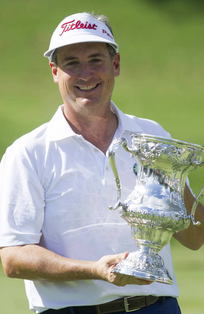 Michael McCoy holds the trophy winning the U.S. Mid-Amateur Championship golf tournament at Country Club of Birmingham on Thursday, Oct. 10, 2013, in Birmingham, Ala