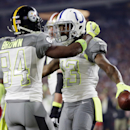 Indianapolis Colts' T .Y. Hilton celebrates with Pittsburgh Steelers' Antonio Brown (84) after scoring a touchdown during the first half of the NFL Football Pro Bowl Sunday, Jan. 25, 2015, in Glendale, Ariz The Associated Press
