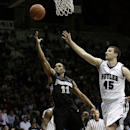 Providence guard Bryce Cotton (11) shoots in front of Butler forward Andrew Chrabascz (45) during the second half of an NCAA college basketball game in Indianapolis, Sunday, Feb. 23, 2014. Providence won 87-81 The Associated Press