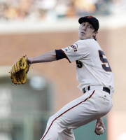 San Francisco Giants starting pitcher Tim Lincecum throws to the Pittsburgh Pirates during the first inning of a baseball game on Saturday, Aug. 24, 2013, in San Francisco. (AP Photo/Marcio Jose Sanchez)