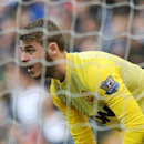 Manchester United goalkeeper David De Gea watches the ball during the English Premier League soccer match between West Bromwich Albion and Manchester United at The Hawthorns Stadium in West Bromwich, England, Saturday, March 8, 2014