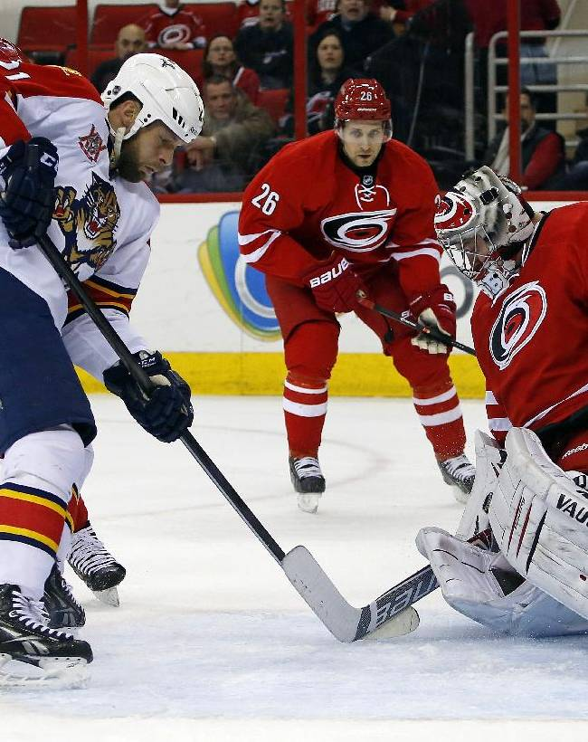 Florida Panthers' Krys Barch (21) looks for the rebound off Carolina Hurricanes goalie Anton Khudobin (31) of Kazakhstan, during the first period of an NHL hockey game in Raleigh, N.C., Saturday, Jan. 18, 2014