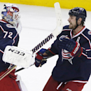Columbus Blue Jackets goalie Sergei Bobrovsky (72) celebrates with Brandon Dubinsky (17) after winning a 4-3 shootout against the Pittsburgh Penguins during an NHL hockey game in Columbus, Ohio Saturday, Dec. 13, 2014 The Associated Press
