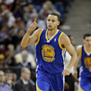 Golden State Warriors guard Stephen Curry flashes one finger after scoring a three-point shot against the Sacramento Kings in an NBA basketball game in Sacramento, Calif., Sunday, Dec. 1, 2013. Curry scored 36 points, including the two free throws with 8.