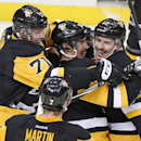 Pittsburgh Penguins' Blake Comeau (17) celebrates his third goal of the game with Sidney Crosby, center, and Evgeni Malkin (71) during the overtime period of an NHL hockey game against the Toronto Maple Leafs in Pittsburgh Wednesday, Nov. 26, 2014. The P