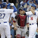 Los Angeles Dodgers' Andre Ethier, right, and Matt Kemp, left, celebrate a three-run home run hit by Ethier in front of Arizona Diamondbacks catcher Miguel Montero during the fourth inning of a baseball game on Saturday, April 19, 2014, in Los Angeles The