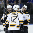 Boston Bruins' Dougie Hamilton, left, and Milan Lucic, right, celebrate Jarome Iginla's goal during the first period of an NHL hockey game against the New York Rangers on Sunday, March 2, 2014, in New York The Associated Press