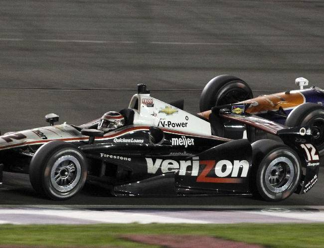 Will Power (12), of Australia, gets a challenge from Charlie Kimball, right, during the IndyCar auto race at the Auto Club Speedway, Saturday, Oct. 19, 2013, in Fontana, Calif.  Power won the race