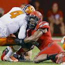 In this Sept. 27, 2014, file photo, Nebraska defensive end Randy Gregory, right, wrestles down Illinois quarterback Reilly O'Toole (4) in the first half of an NCAA college football game in Lincoln, Neb. Gregory is back in top form after he tweaked an old