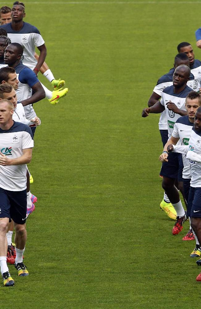 The French national soccer team players attends a training session at the Stade de France in Saint Denis, outside Paris, Wednesday, Sept. 3, 2014. France will play an international friendly soccer match against Spain in Saint Denis on Thursday, Sept. 4