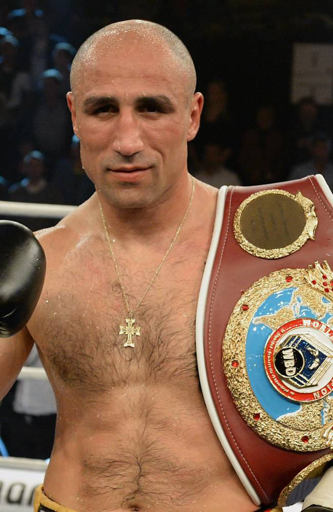 Germany's WBO supermiddleweight champion Arthur Abraham shows his belt after defending his title against his challenger Britain's Paul Smith in Kiel, northern Germany, Saturday evening, Sept. 27, 2014.