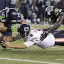 Chicago Bears quarterback Jimmy Clausen (8) falls just short of the goal line as he comes down between Seattle Seahawks' Brock Coyle (45) and Terrance Parks in the second half of an preseason NFL football game, Friday, Aug. 22, 2014, in Seattle The Associ