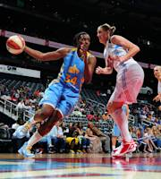 ATLANTA - JUNE 2: Sylvia Fowles #34 of the Chicago Sky drives against Cathrine Kraayeveld #33 of the Atlanta Dream at Philips Arena on June 2, 2012 in Atlanta, Georgia.  (Photo by Scott Cunningham/NBAE via Getty Images)