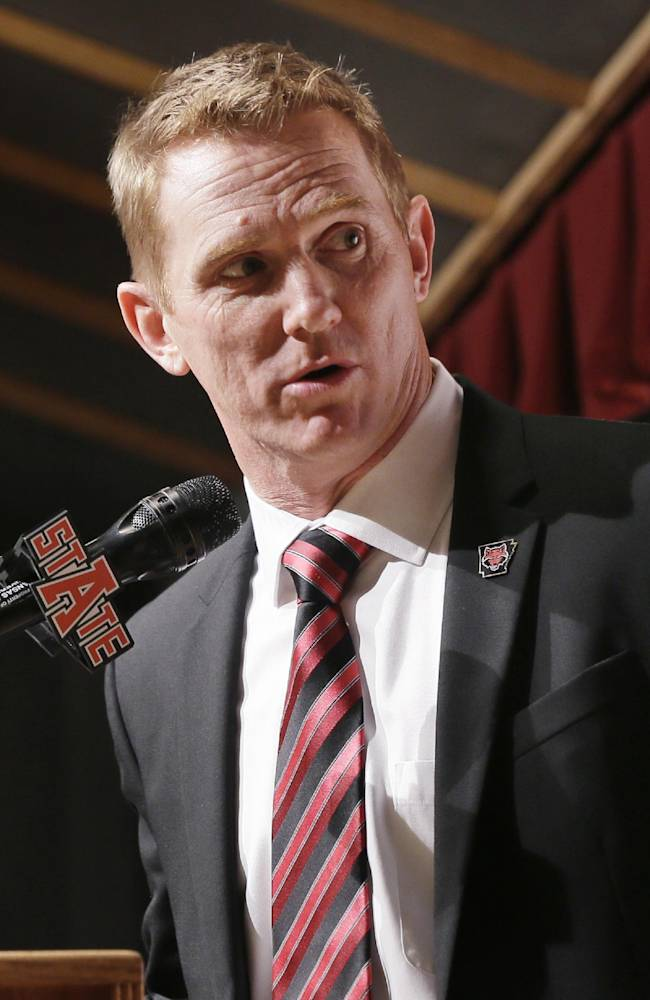Former North Carolina offensive coordinator Blake Anderson speaks at a news conference at Arkansas State in Jonesboro, Ark., Thursday, Dec. 19, 2013. Anderson was named head football coach at Arkansas State, Thursday