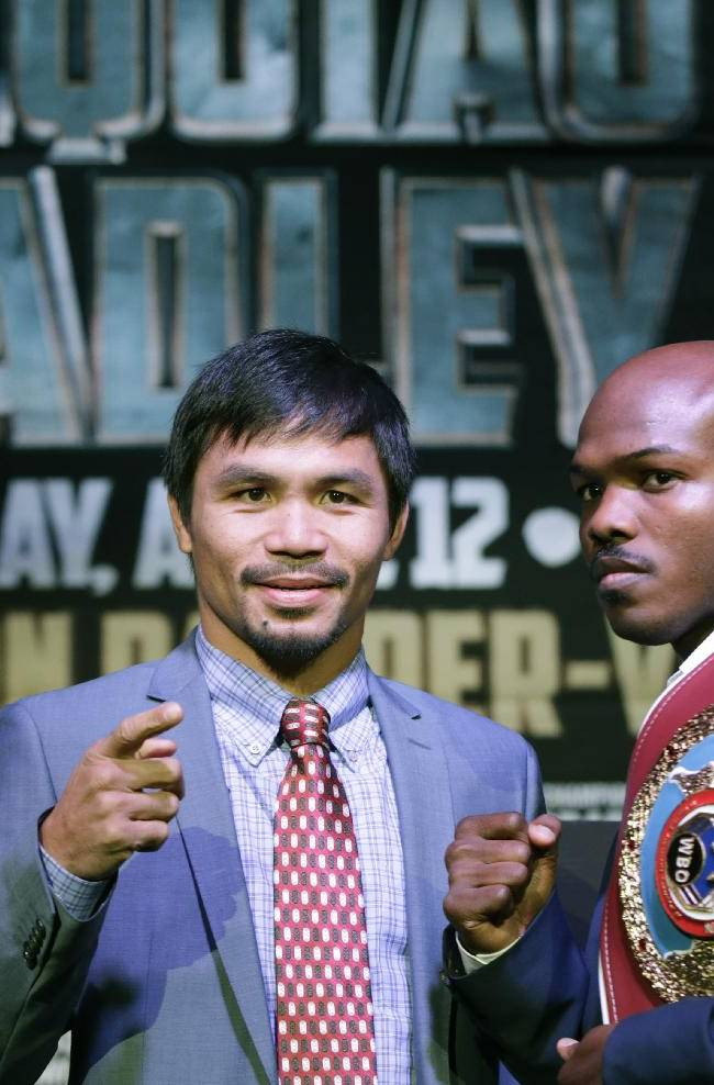 Boxer Manny Pacquiao, of the Phillipines, left, poses for a photo with current WBO World Welterweight champion Timothy Bradley of Indio, Ca., during a press conference,Thursday, Feb. 6, 2014, in New York. The pair will face off in a title fight in Las Vegas, April 12, 2014