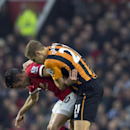 Manchester United's Robin van Persie , left, fights for the ball against Hulls Michael Dawson during the English Premier League soccer match between Manchester United and Hull City at Old Trafford Stadium, Manchester, England, Saturday Nov. 29, 2014