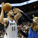Dallas Mavericks' Shawn Marion, right, knocks the ball away from Minnesota Timberwolves' Nikola Pekovic, of Montenegro, who was attempting to shoot in the first quarter of an NBA basketball game on Friday, Nov. 8, 2013, in Minneapolis The Associated Press