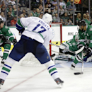 Vancouver Canucks' Radim Vrbata (17), of the Czech Republic, scores on a shot against Dallas Stars goalie Kari Lehtonen (32), of Finland, as Cody Eakin (20) and Trevor Daley (6) help defend during the second period of an NHL hockey game, Tuesday, Oct. 21,