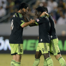 Seattle Sounders forward Obafemi Martins, center, celebrates with Seattle Sounders midfielder Gonzalo Pienda, left, and Seattle Sounders midfielder Marco Papa, right, after he assists a goal to Seattle Sounders midfielder Lamar Neagle during the second h