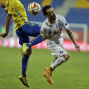Dynamo Moscow's Mathieu Valbuena, right, tussles for the ball with Estoril's Anderson Luiz during the Europa League group E soccer match between Dynamo Moscow and Estoril at the Antonio Coimbra Da Mota stadium, in Estoril, Portugal, Thursday, Oct. 23, 201