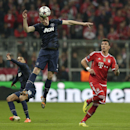Manchester United's Phil Jones heads the ball clear during the Champions League quarterfinal second leg soccer match between Bayern Munich and Manchester United in the Allianz Arena in Munich, Germany, Wednesday, April 9, 2014