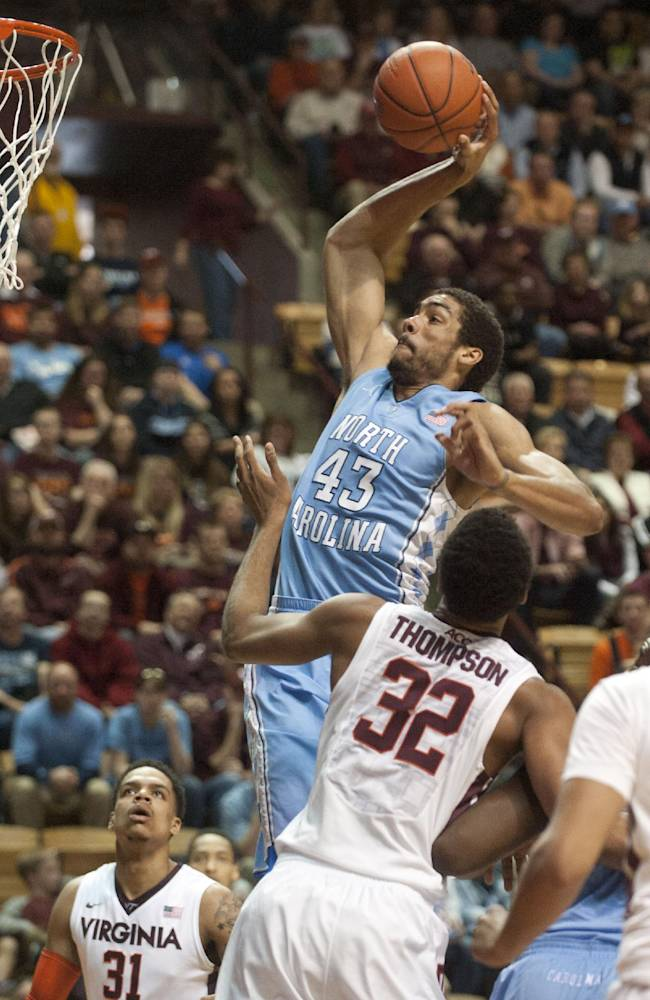 North Carolina's  James McAdoo (43)  goes up for a dunk against Virginia Tech's Trevor Thompson during the first half of an NCAA college basketball game,  Saturday, March 1, 2014, in Blacksburg, Va