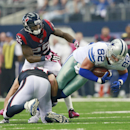 Dallas Cowboys tight end Jason Witten (82) gets a first down while tackled by Houston Texans linebacker Mike Mohamed (54) and Kareem Jackson (25) during the second half of an NFL football game, Sunday, Oct. 5, 2014 in Arlington, Texas The Associated Press
