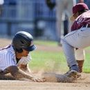 Arizona's Alex Mejia, left, steals third base against Florida State third baseman Sherman Johnson, in the first inning of an NCAA College World Series baseball game in Omaha, Neb., Thursday, June 21, 2012. (AP Photo/Eric Francis)