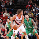 PORTLAND, OR - OCTOBER 17: Robin Lopez #42 of the Portland Trail Blazers handles the ball against Maccabi Haifa on October 17, 2014 at the Moda Center Arena in Portland, Oregon. (Photo by Sam Forencich/NBAE via Getty Images)