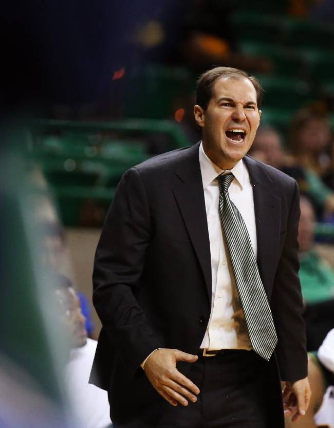 Baylor head coach Scott Drew calls for a foul against Northwestern State in the second half of an NCAA college basketball game, Wednesday, Dec. 18, 2013, in Waco, Texas. Baylor won in overtime 91-84