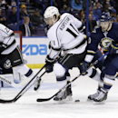 St. Louis Blues' Maxim Lapierre, right, and Los Angeles Kings' Anze Kopitar, of Slovinia, chase after a loose puck as Kings' Dustin Brown, left, watches during the first period of an NHL hockey game Tuesday, Dec. 16, 2014, in St. Louis The Associated Pres