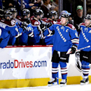 Colorado Avalanche left wing Gabriel Landeskog (92), from Sweden, celebrates a goal against the Vancouver Canucks with teammates on the bench during the second period of an NHL hockey game on Thursday, March 27, 2014, in Denver The Associated Press