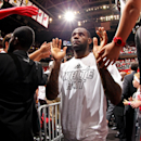 LeBron James #6 of the Miami Heat greets fans following his team's victory against the Chicago Bulls in Game Two of the Eastern Conference Semifinals during the 2013 NBA Playoffs on May 8, 2013 at American Airlines Arena in Miami, Florida. (Photo by Issac Baldizon/NBAE via Getty Images)