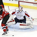 Washington Capitals goalie Braden Holtby, right, defends against New Jersey Devils left wing Tuomo Ruutu, of Finland, during the third period of an NHL hockey game, Saturday, Dec. 6, 2014, in Newark, N.J. The Capitals won 4-1 The Associated Press