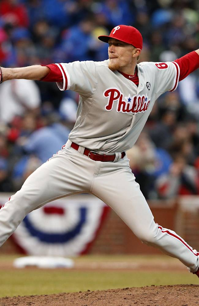 Philadelphia Phillies relief pitcher Jacob Diekman delivers against the Chicago Cubs during the sixth inning of a baseball game on Friday, April 4, 2014, in Chicago