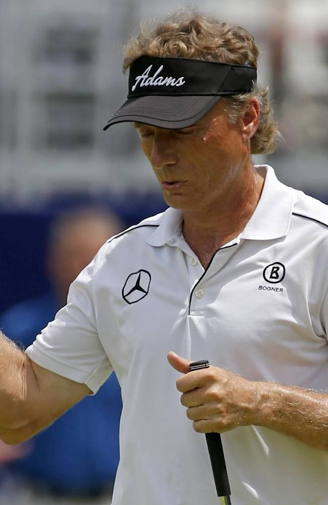Bernhard Langer of Germany celebrates after sinking a birdie putt on the 18th hole during the second round of the Senior Players Championship golf tournament at Fox Chapel Golf Club in Pittsburgh, Friday, June 27, 2014